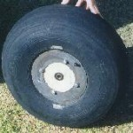 A fat tire made from a discarded Cessna 600x6 tire and a wood hub as mentioned below.